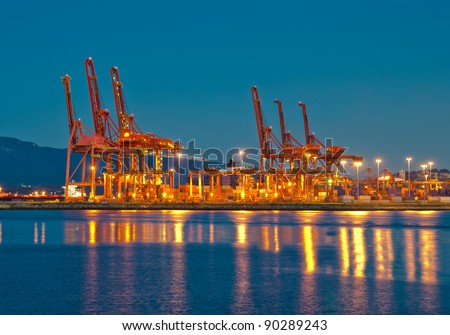 cranes at the container port terminal in Vancouver BC sunset time