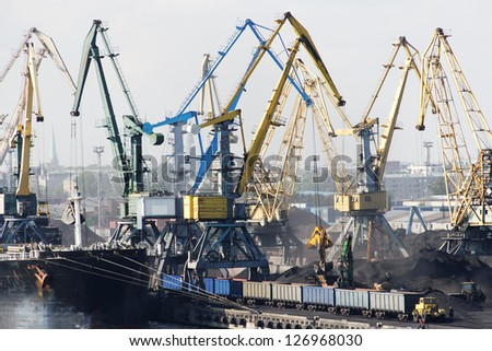 Cranes in port. - stock photo