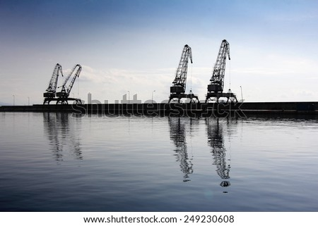 Cranes in the ship's port as silhouettes, in Rijeka in Croatia - stock photo
