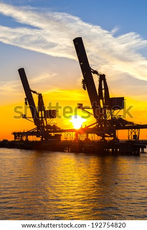 Cranes loader and conveyors to transport coal. - stock photo