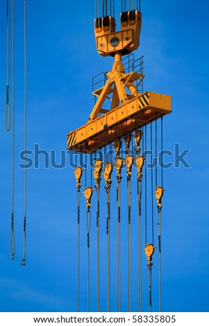 Cranes of the dockyards of Cadiz in a sunny day - stock photo
