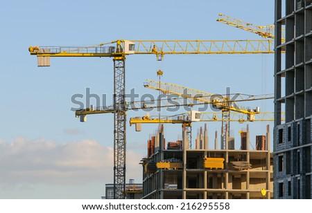 Cranes on construction site. - stock photo