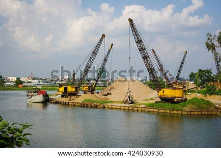 stock-photo-cranes-on-the-river-42403093