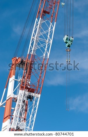 cranes with a hook on a construction site