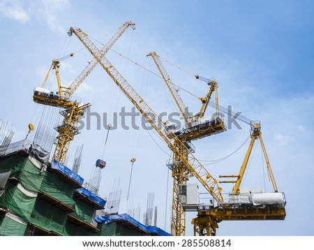 Cranes work in construction site - stock photo