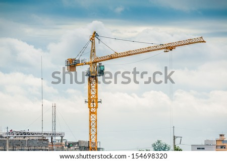 Cranes working in construction.