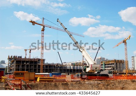 Cranes working on a building site. Construction of residential complex Green Park. Moscow. May 2016