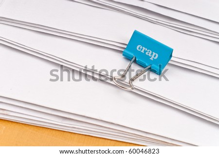 Crap Note Clip on Staggered Envelopes - stock photo