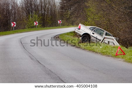 Crashed car after accident into a ditch