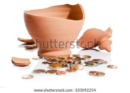 crashed moneybox and coins isolated over white background
