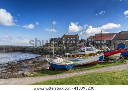 Craster harbour a fishing port on the Northumberland coast - stock photo