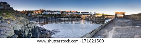 Craster Harbour panoramic / The Northumberland coastal village of Craster with its harbour is famous for smoked kippers and nearby Dunstanburgh Castle