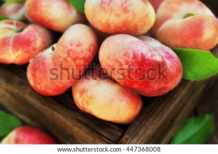 Crate of fresh ripe sweet peaches, selective focus, shallow DOF - stock photo