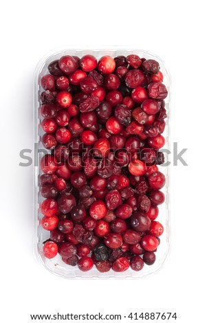 Crate with red cranberries, isolated on white background