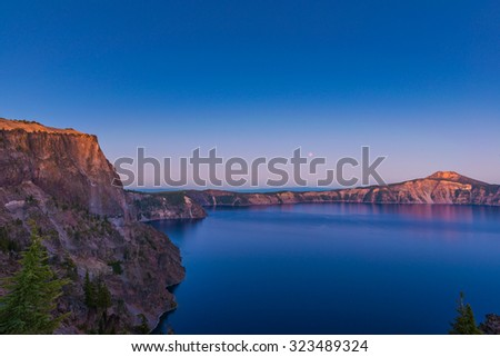 Crater lake when sunset on blood moon day in Crater Lake National Park ,Oregon,Usa - stock photo