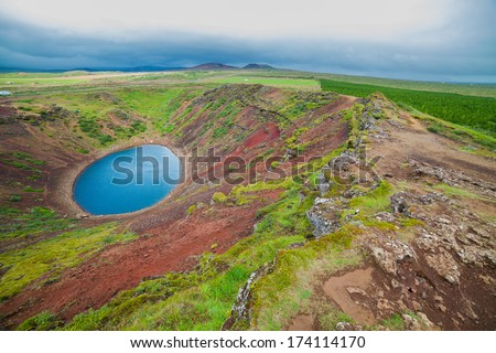 Crater of a old active volcano Kerith filled with water. Iceland, Europe - stock photo