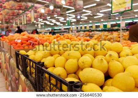 Crates with citrus fruits in a food store - stock photo