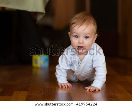 Crawling baby  about the room - stock photo