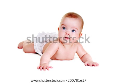 crawling baby girl on white blanket looking to the side.