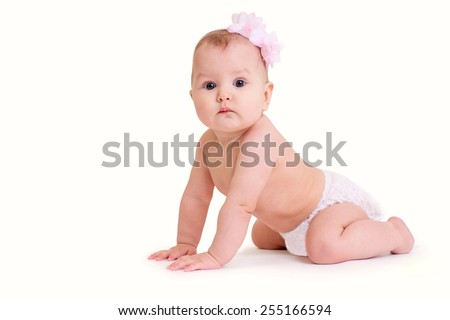 Crawling baby girl with flowers isolated on white background