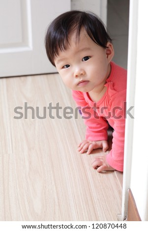 crawling girl baby on living room floor, asian child - stock photo