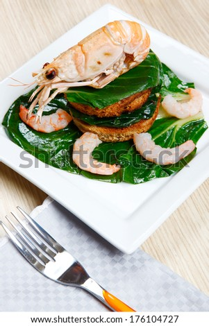 crayfish on a toast with vegetables on a dish