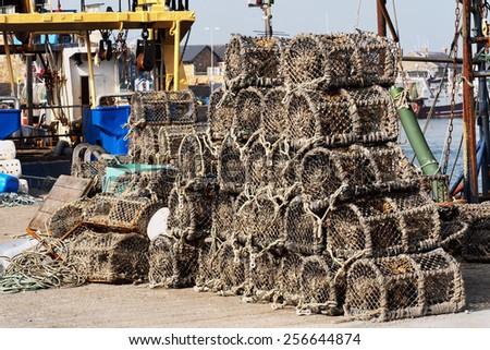 Crayfish traps in harbor, Ireland - stock photo