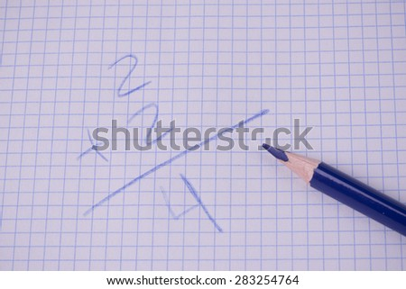 Crayon blue with sum on graph paper - stock photo