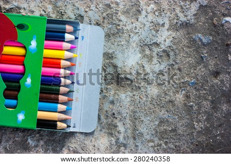 Crayon Box wood with old dirty cement floor. - stock photo