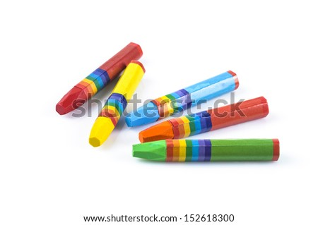 Crayons in different colors on white background