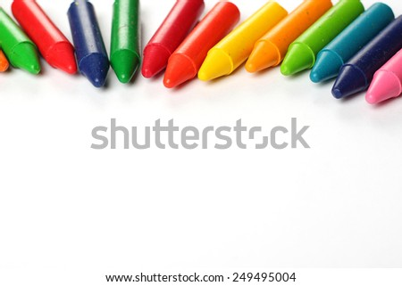 Crayons lying on a paper. Selective focus, copy space background - stock photo