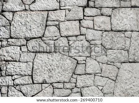 Crazed white granite stone wall background. - stock photo