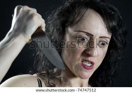 crazed woman stabbing with a large kitchen knife
