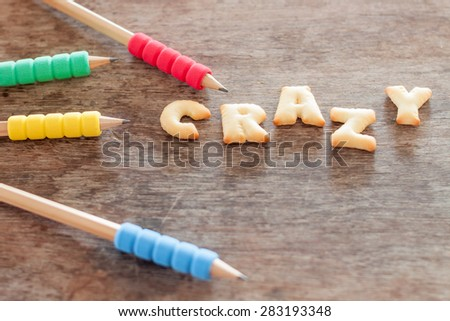 Crazy alphabet biscuit on wooden table, stock photo - stock photo