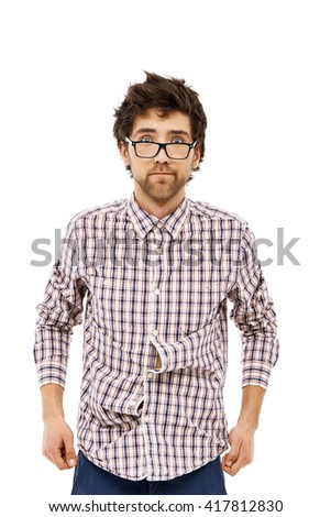 Crazy and funny handsome young man in jeans, plaid shirt and glasses with messy hair looking at camera. Isolated on white background. - stock photo