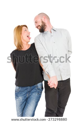 Crazy and funny young couple in love posing on white background - stock photo