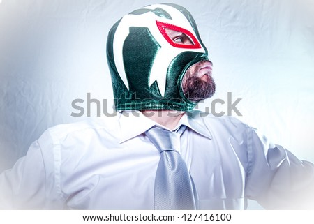 Crazy, angry businessman with Mexican wrestler mask, expressions of anger and rage - stock photo