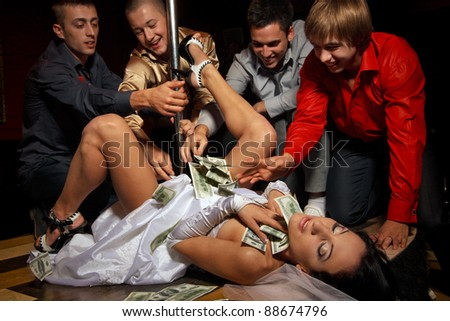 Crazy bachelor's party in strip club - stock photo