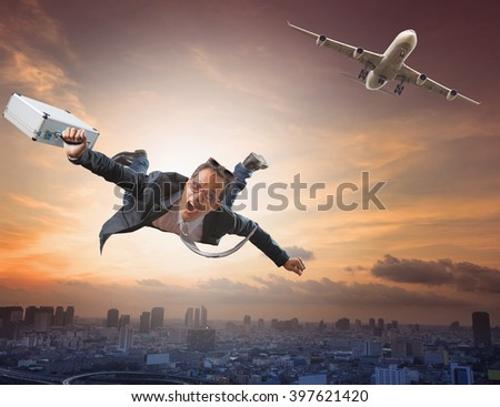 crazy business man flying from passenger plane and luggage in hand