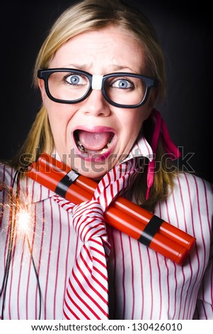 Crazy business woman screaming with lit bomb under striped tie while a deadline of explosive stress looms - stock photo