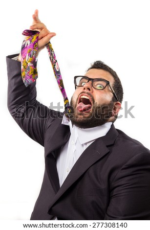 Crazy businessman chocked with his tie - stock photo