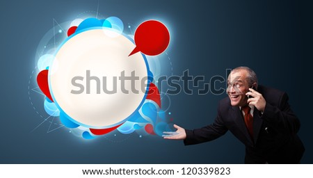 crazy businessman in suite holding a phone and presenting abstract modern speech bubble with copy space