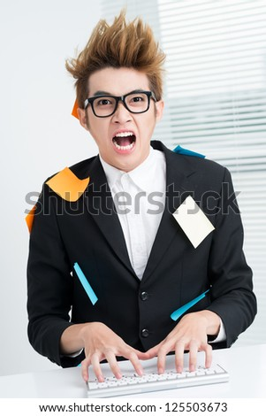 Crazy businessman sitting at table