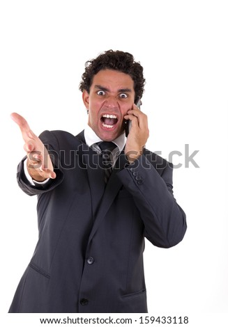 crazy businessman  while he talking on mobile - stock photo