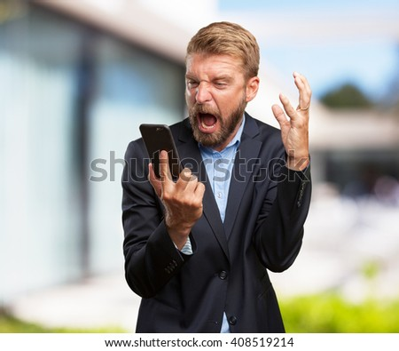 crazy businessman worried expression - stock photo