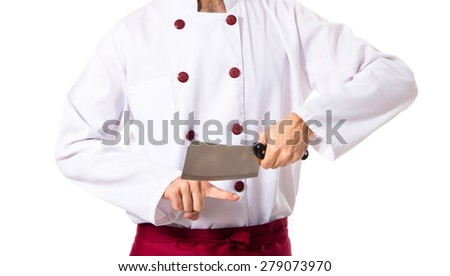 Crazy chef cutting his finger - stock photo