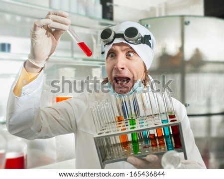 Crazy chemist puts science experiment in laboratory - stock photo