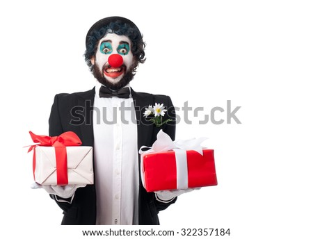 crazy clown man with gifts - stock photo