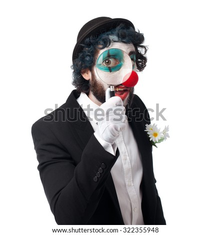 crazy clown man with magnifying glass