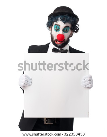 crazy clown man with placard - stock photo